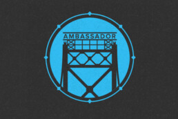 Blue and black logo featuring Detroit's Ambassador Bridge