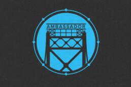Blue and black logo featuring Detroit's Ambassador Bridge